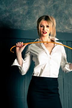 mistress-scarlet-in-white-blouse-black-skirt-flexing-cane