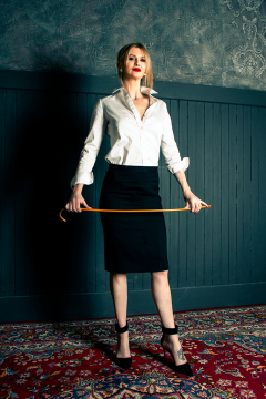 mistress-scarlet-in-white-blouse-black-skirt-standing-with-cane