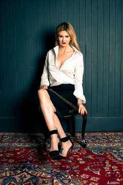 mistress-scarlet-in-white-blouse-black-skirt-with-tawse