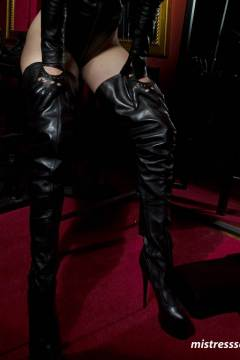 mistress-scarlet-thigh-high-boots-in-dungeon