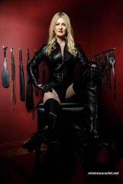 mistress-scarlet-thigh-high-boots-sitting-in-dungeon