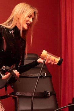 mistress-scarlet-leaning-on-fetters-gynaecological-chair