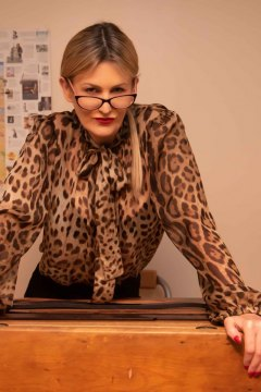mistress-scarlet-leaning-on-teachers-desk